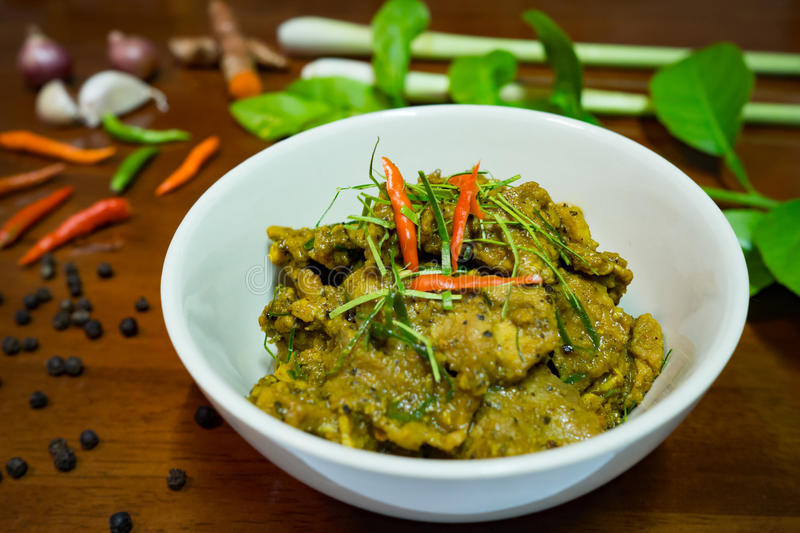 Fried spicy pork boar with herbs, traditional Thai cuisine dish with many herbs. Lemongrass, pepper, chili, lime leaves, garlic stock photography
