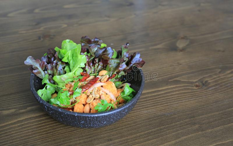 Fried spicy salmon salad mixed vegetable and herb.  stock photo