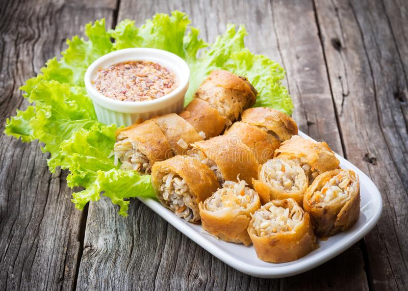 Fried spring rolls. Sliced spring roll served with sweet and spicy sauced. Asian vegetarian appetizer. royalty free stock photo