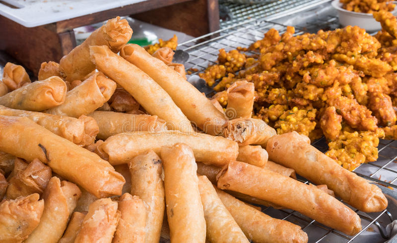 Fried spring rolls in street shop.  royalty free stock images