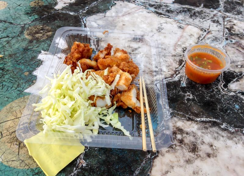 Fried squid with hot spicy sauce,Thai street food vendor in Bangkok, Thailand. Background royalty free stock photos