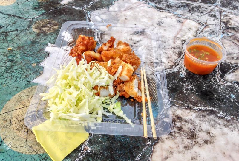 Fried squid with hot spicy sauce,Thai street food vendor in Bangkok, Thailand. Background stock images