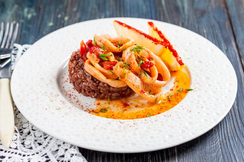 Fried squid rings with red rice royalty free stock photography