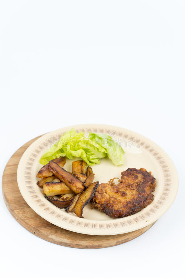 Fried steak potatoes and lettuce royalty free stock photo