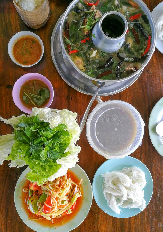 Fried striped snakehead fish, hot pot of Thai style spicy soup, stock photo