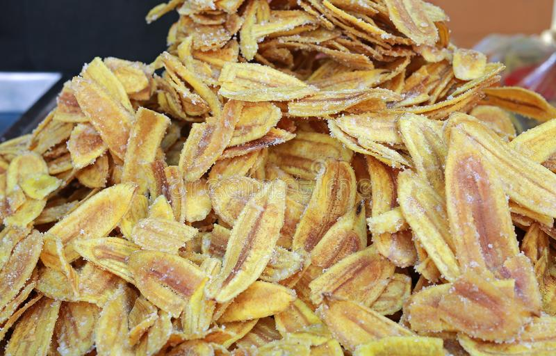 Fried thinly sliced banana chips with sugar.  stock images