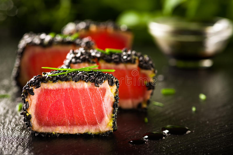 Fried tuna steak in black sesame royalty free stock photos