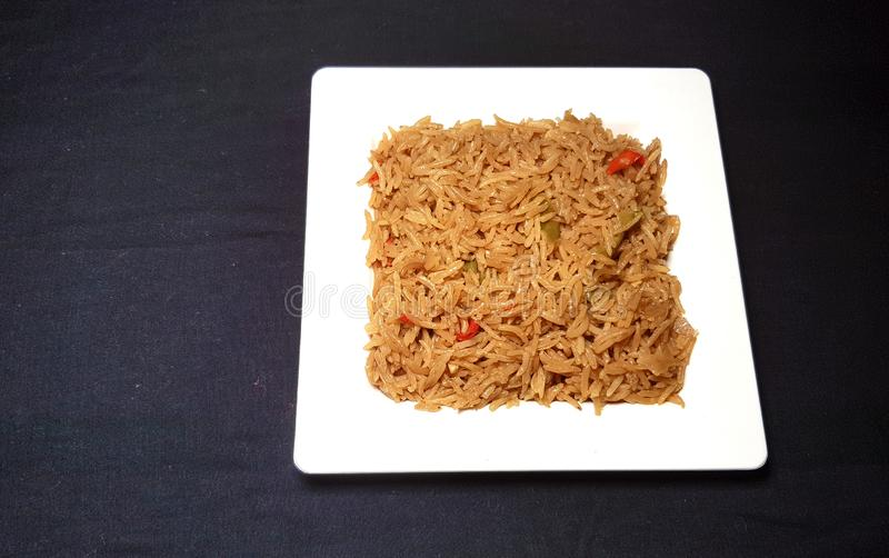 Fried vegetable rice. In white plate on black background royalty free stock photography