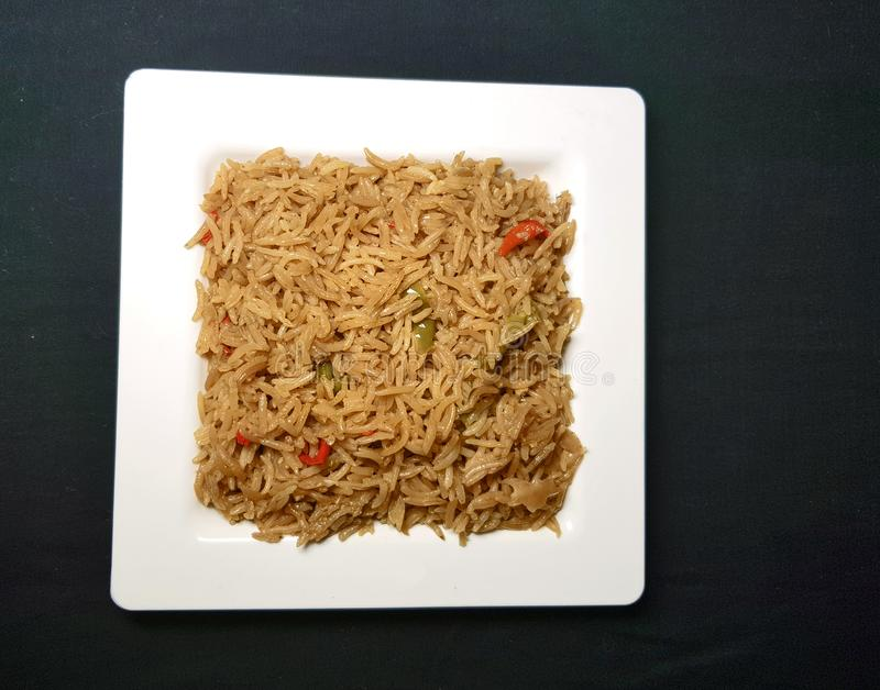 Fried vegetable rice. In white plate on black background royalty free stock photos