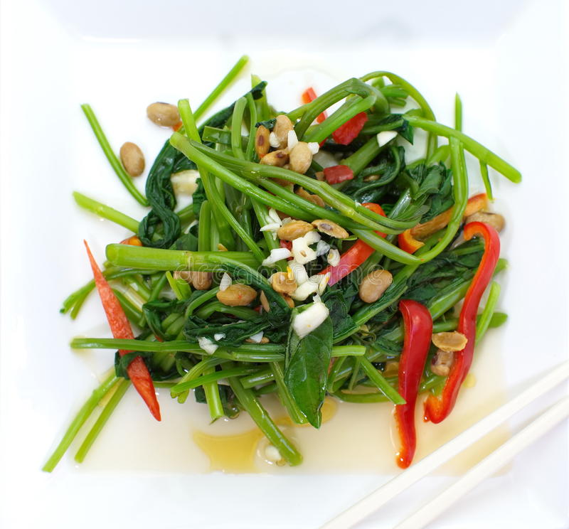Fried water spinach with chil. Quick fried water spinach with chili and soy sauce royalty free stock photos