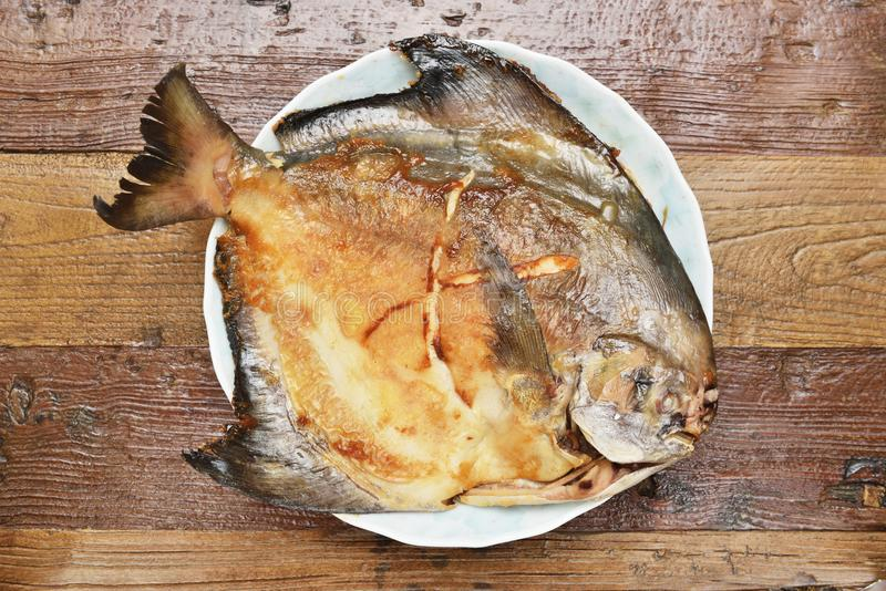 Fried white pomfret stock photo