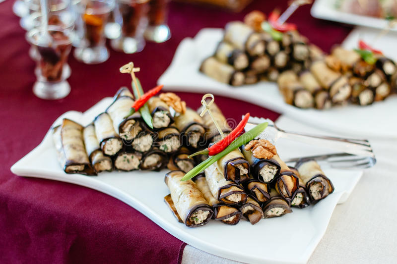 Fried zucchini with stuffing, delicious rolls royalty free stock photo