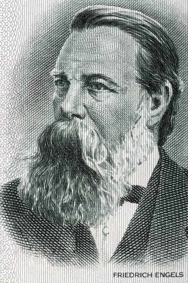 Friedrich Engels stående från gamla tyska pengar arkivfoto