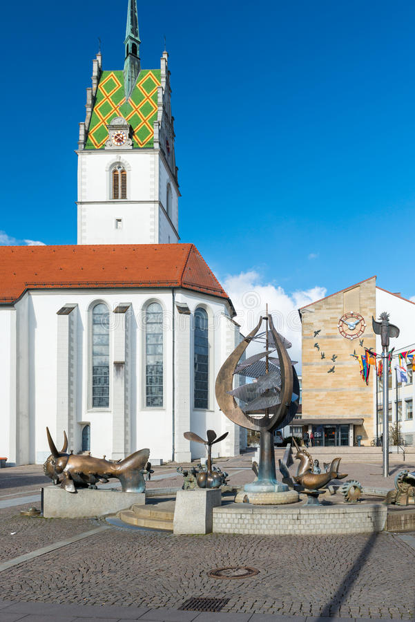 Friedrichshafen, Germany. February 17, 2014: St. Nikolaus Church and City Hall in Friedrichshafen stock photography