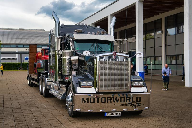 FRIEDRICHSHAFEN - MAY 2019: black KENWORTH W900 1961 conventional-cab truck at Motorworld Classics Bodensee on May 11, 2019 in royalty free stock image