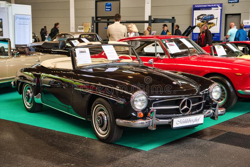 FRIEDRICHSHAFEN - MAY 2019: black MERCEDES-BENZ 190 SL 1961 cabrio roadster at Motorworld Classics Bodensee on May 11, 2019 in royalty free stock photography