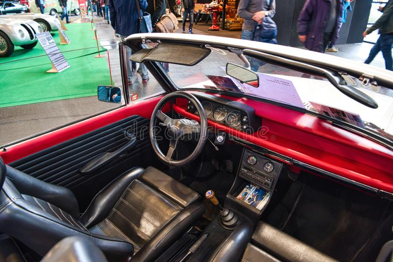 FRIEDRICHSHAFEN - MAY 2019: black red leather interior of BMW 02 1600 1967 cabrio at Motorworld Classics Bodensee on May 11, 2019. FRIEDRICHSHAFEN - MAY 2019 stock image