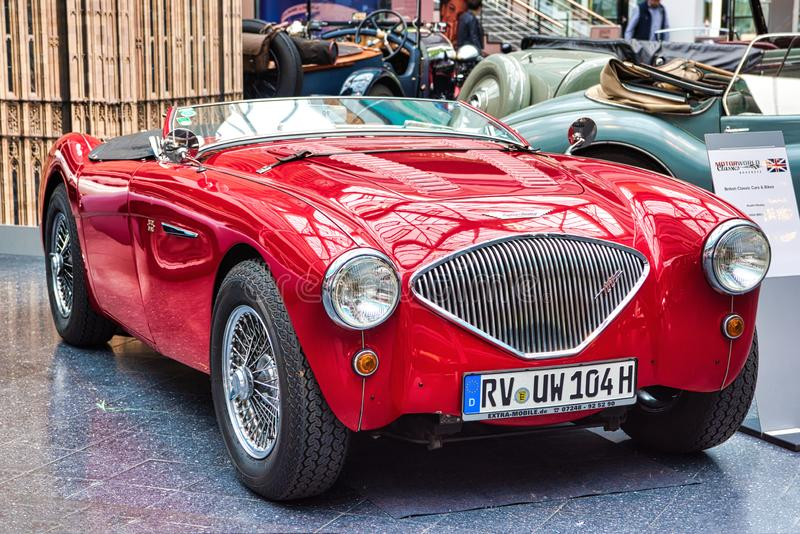 FRIEDRICHSHAFEN - MAY 2019: red AUSTIN-HEALEY 100 BN1 cabrio roadster 1955 at Motorworld Classics Bodensee on May 11, 2019 in stock image