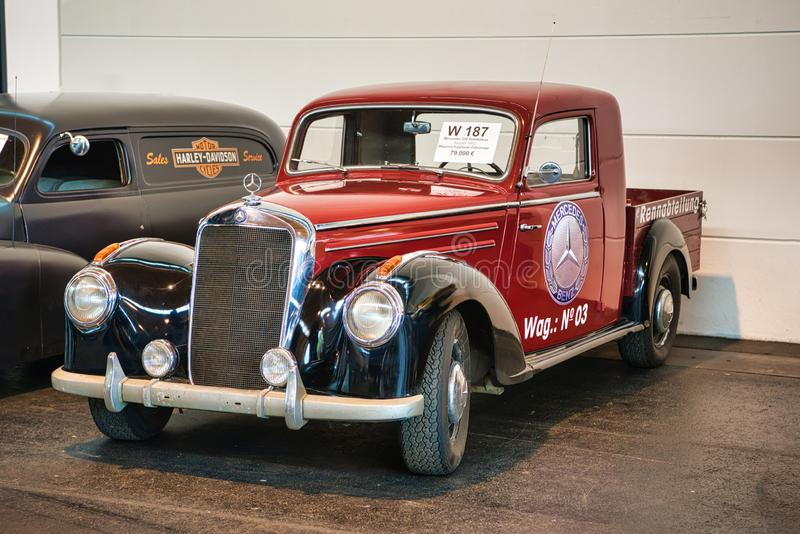 FRIEDRICHSHAFEN - MAY 2019: red black MERCEDES-BENZ 220 W187 1952 pickup at Motorworld Classics Bodensee on May 11, 2019 in. Friedrichshafen, Germany royalty free stock images