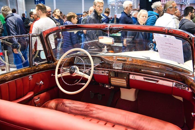 FRIEDRICHSHAFEN - MAY 2019: red interior MERCEDES-BENZ 220 S PONTON W187 1957 cabrio at Motorworld Classics Bodensee on May 11,. 2019 in Friedrichshafen stock photography