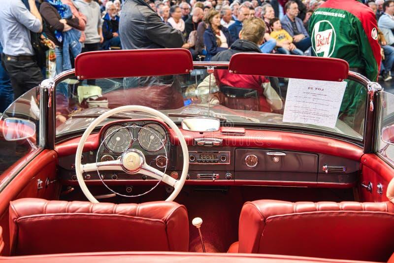 FRIEDRICHSHAFEN - MAY 2019: red interior MERCEDES-BENZ 220 S PONTON W187 1957 cabrio at Motorworld Classics Bodensee on May 11,. 2019 in Friedrichshafen royalty free stock images