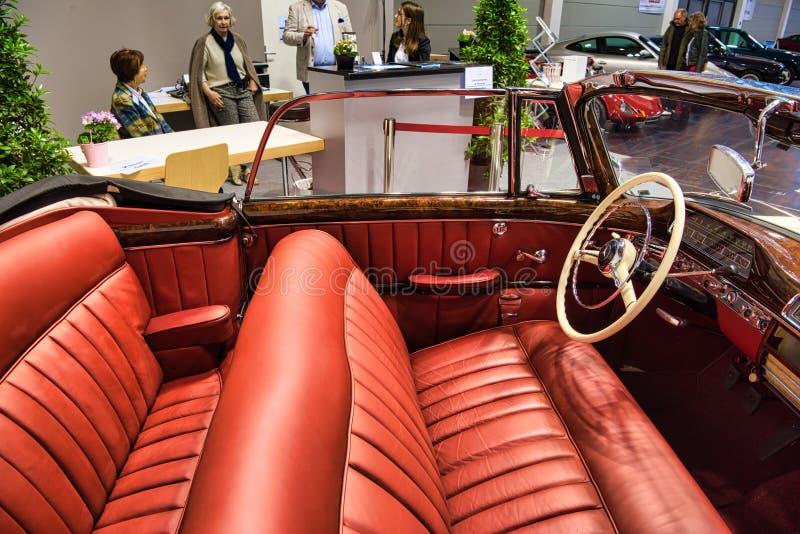 FRIEDRICHSHAFEN - MAY 2019: red interior MERCEDES-BENZ 220 S PONTON W187 1957 cabrio at Motorworld Classics Bodensee on May 11,. 2019 in Friedrichshafen stock photo