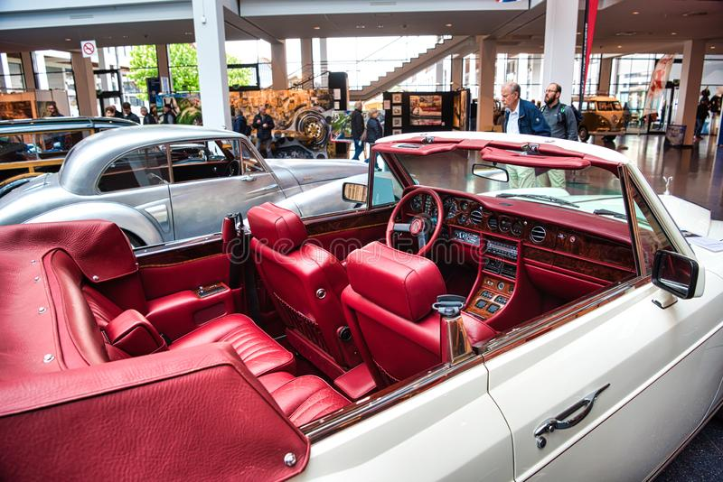 FRIEDRICHSHAFEN - MAY 2019: red interior in white ROLLS-ROYCE CORNICHE 1986 cabrio at Motorworld Classics Bodensee on May 11, 2019 royalty free stock image