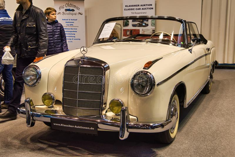 FRIEDRICHSHAFEN - MAY 2019: white beige ivory MERCEDES-BENZ 220 S PONTON W187 1957 cabrio at Motorworld Classics Bodensee on May royalty free stock photography