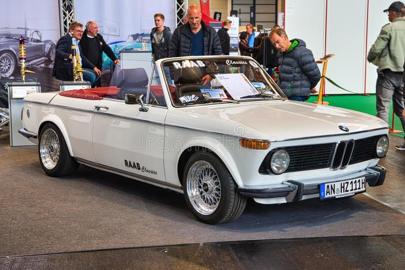 FRIEDRICHSHAFEN - MAY 2019: white BMW 02 1600 1967 cabrio at Motorworld Classics Bodensee on May 11, 2019 in Friedrichshafen,. Germany stock photography