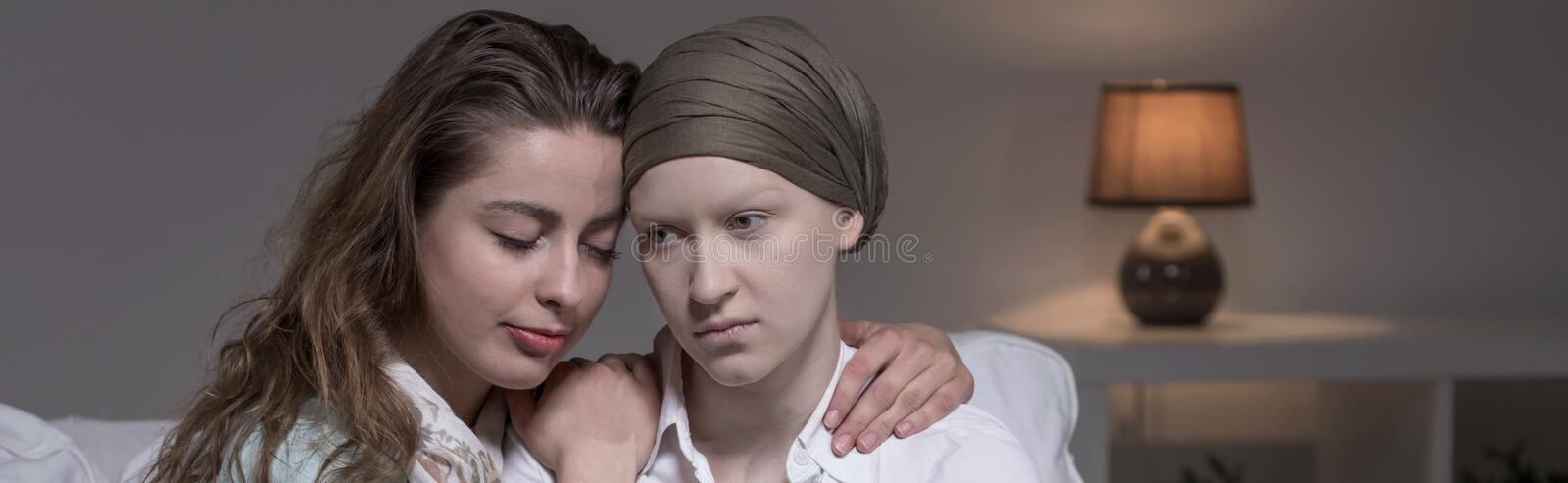 Friend supporting cancer woman stock photo