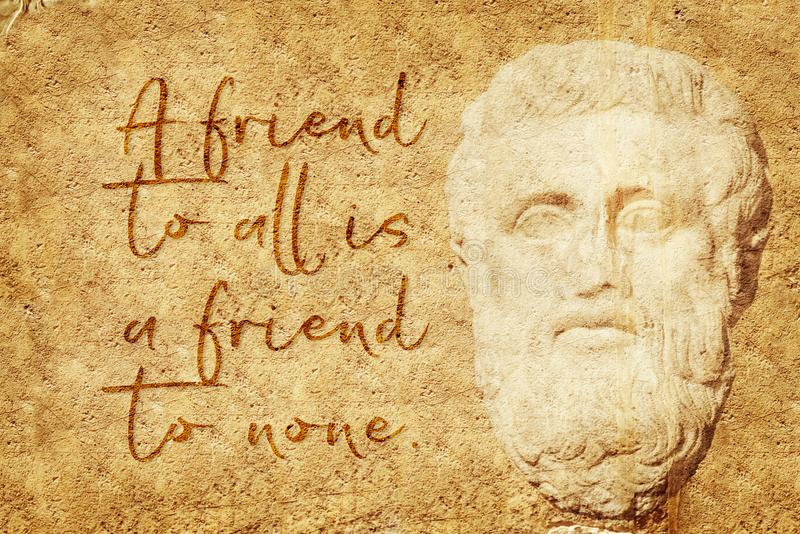 Friend to none Aristotle. A friend to all is a friend to none - famous quote of ancient Greek philosopher Aristotle written on stone wall with carved relief stock illustration