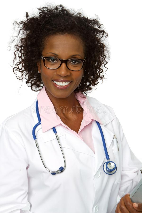 Friendly African American doctor smiling. Friendly African American doctor smiling isolated on white stock photography