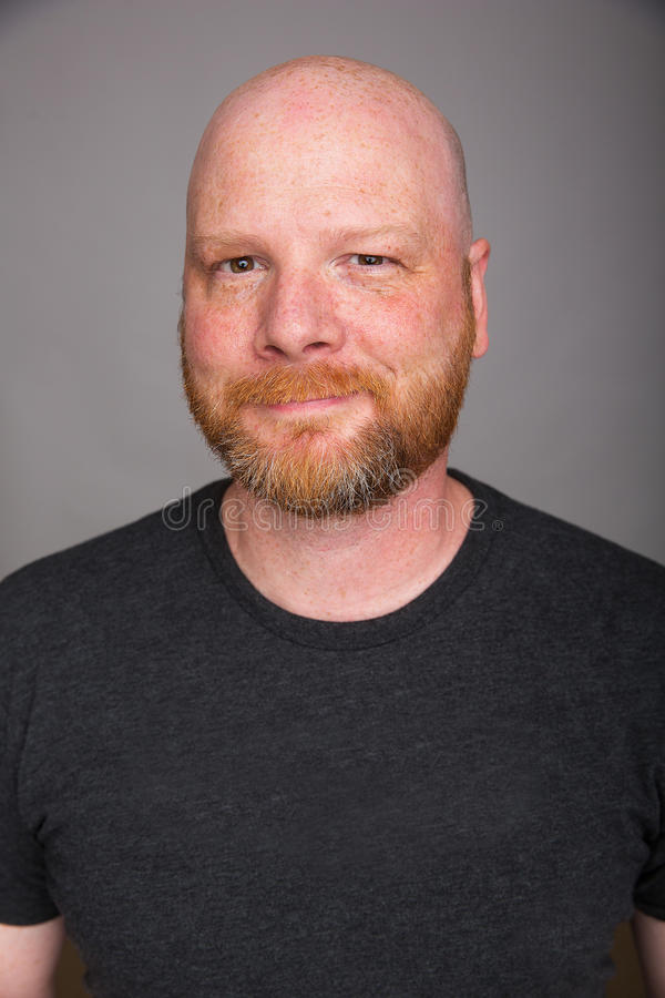 Friendly bald man with a beard stock image