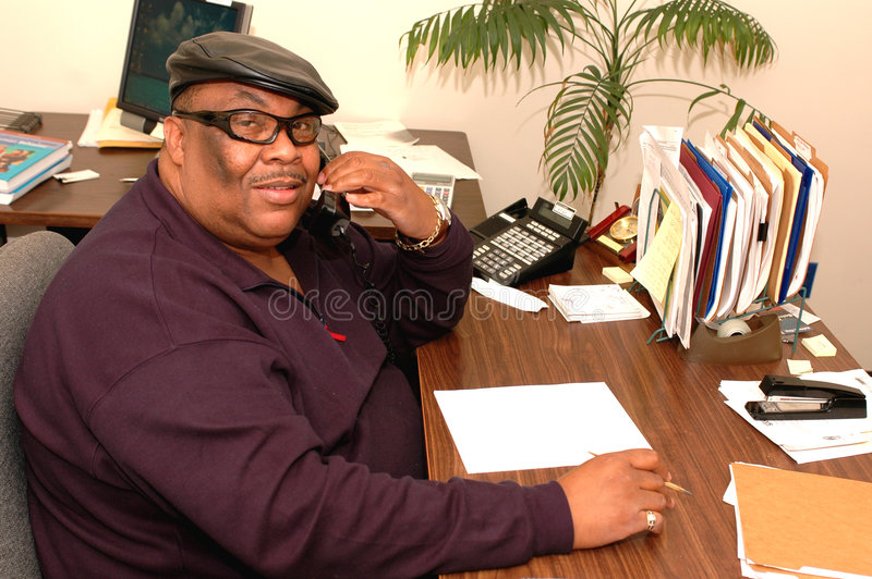 friendly black man in office stock photo