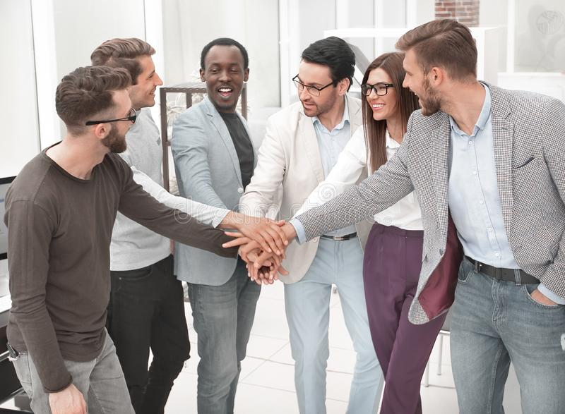 Friendly business team putting their hands together royalty free stock photos