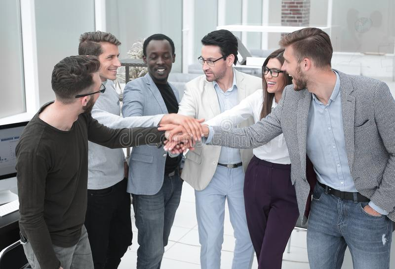 Friendly business team putting their hands together royalty free stock images