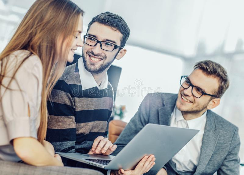 friendly business team working on laptop and discussing busines stock image