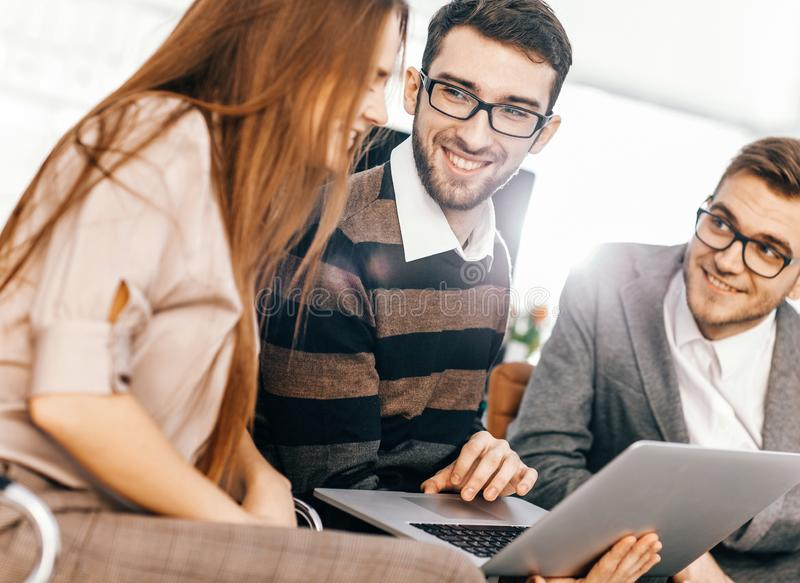 friendly business team working on laptop and discussing busines royalty free stock photography