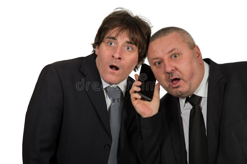 Friendly business using mobile phone in white office royalty free stock photography