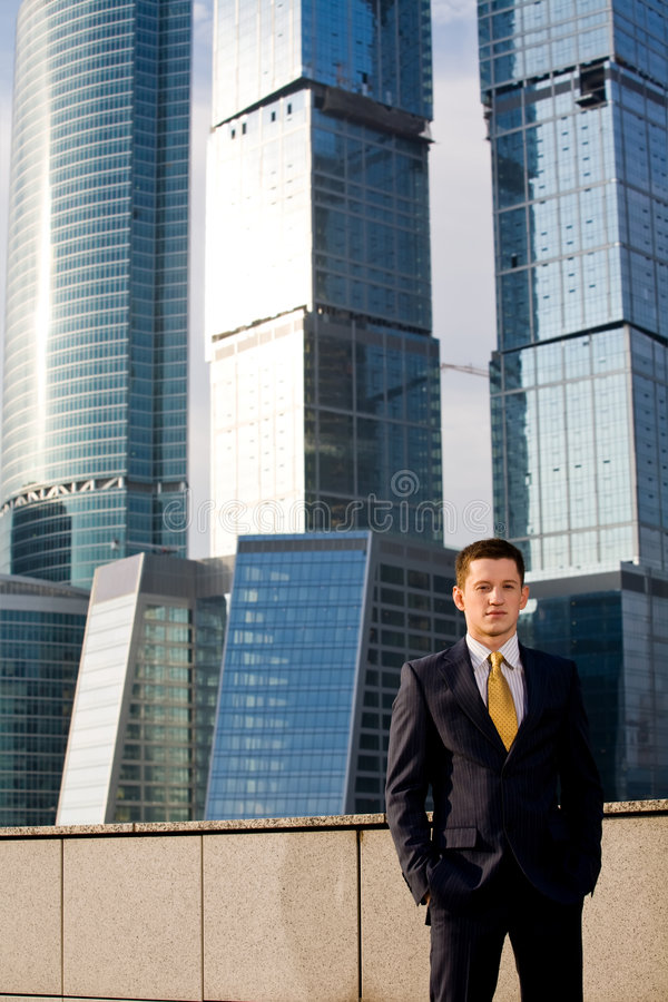 Download Friendly Businessman Standing Against Skyscraper Stock Image - Image: 6900487