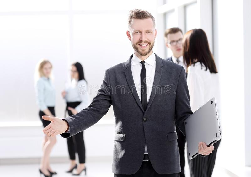 Friendly businessman standing in the lobby of his office stock photos