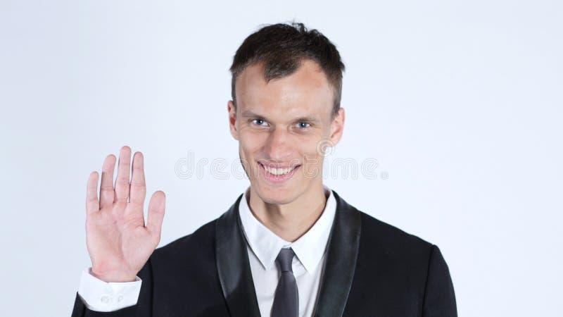 Friendly Businessman waving and saying Hi, isolated on white stock photo