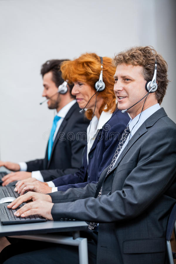 Friendly callcenter agent operator with headset telephone. Support service royalty free stock images