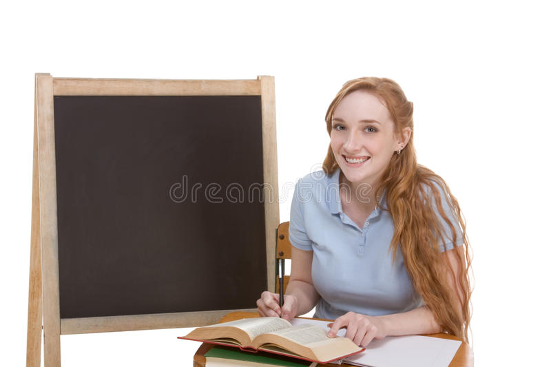 Friendly Caucasian college student by blackboard royalty free stock image