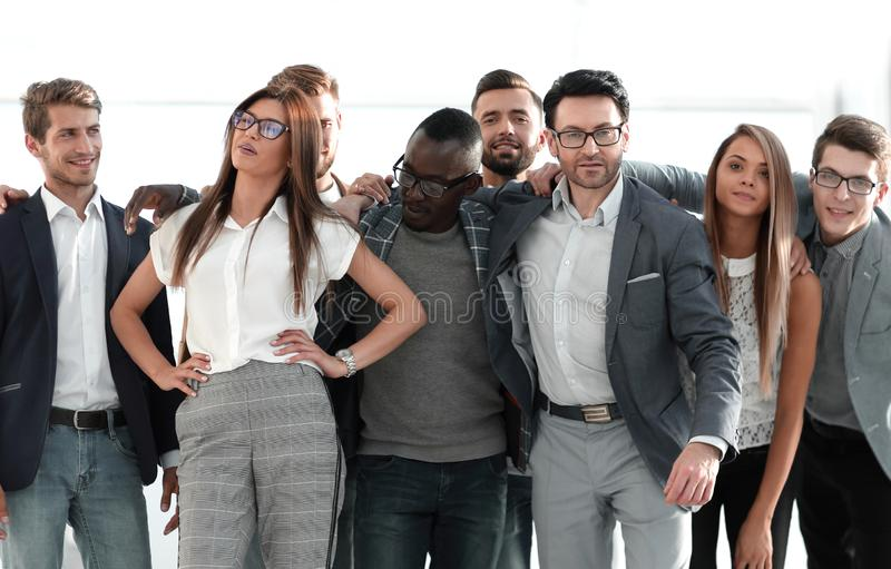 Friendly cheerful business team of young people stock image