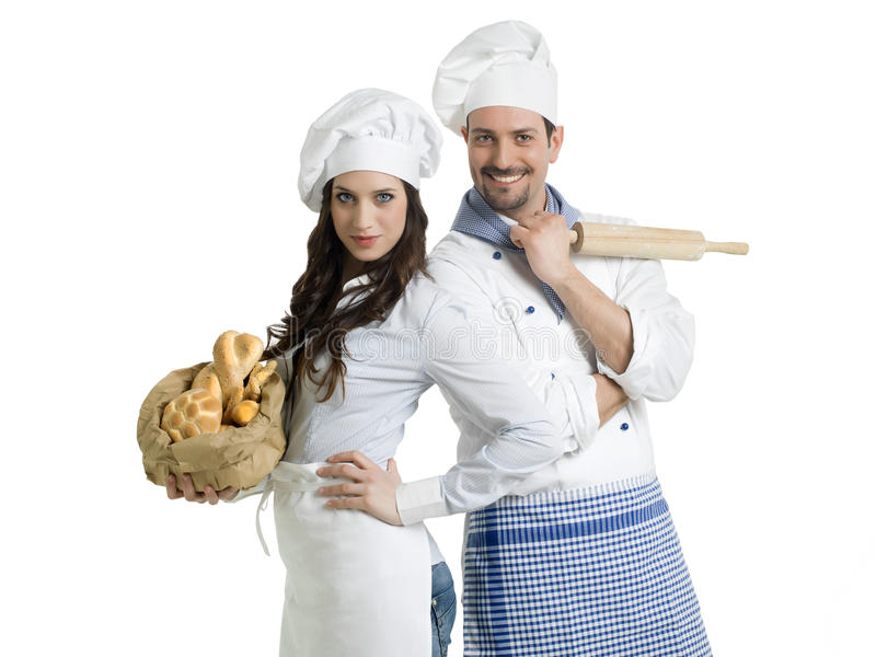 Chefs with bread and rolling pin. Friendly chefs with bread and rolling pin royalty free stock photos