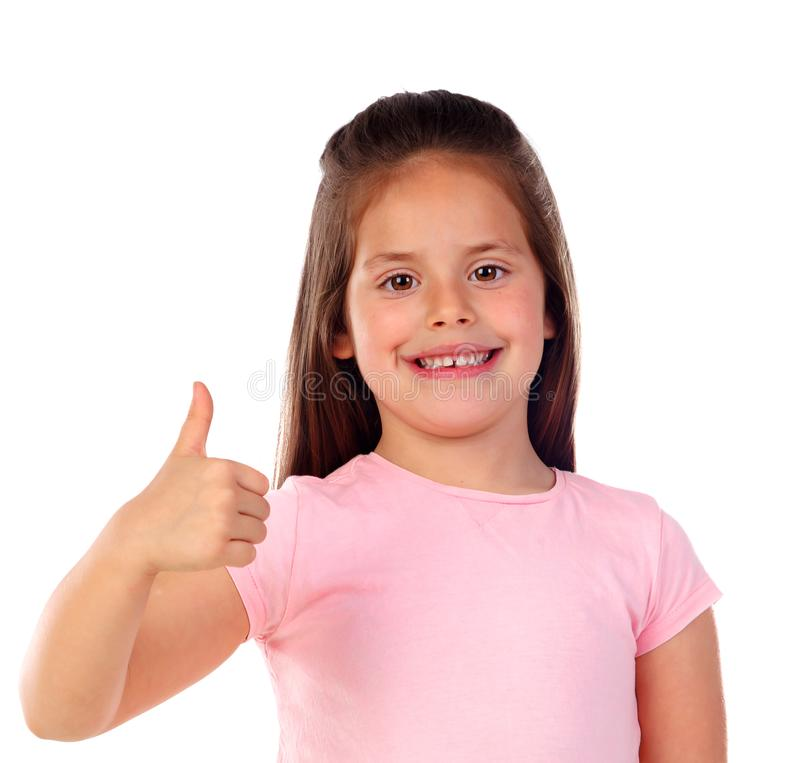 Friendly child saying Ok with her thumb stock image