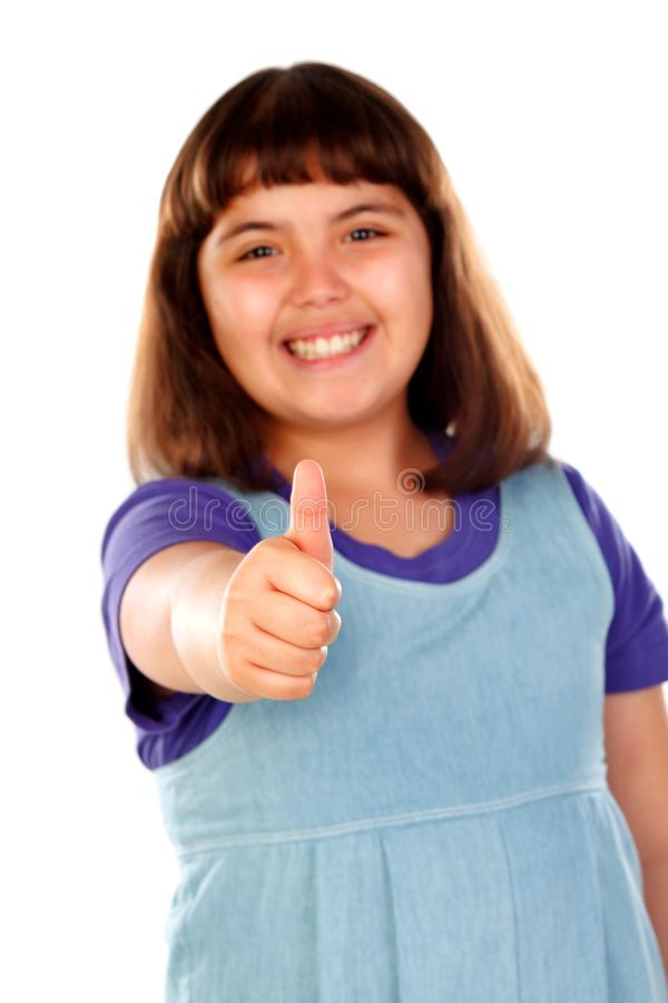 Friendly child saying Ok with her thumbs royalty free stock images