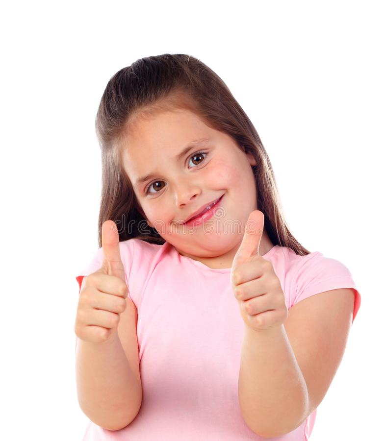 Friendly child saying Ok with her thumbs royalty free stock photography