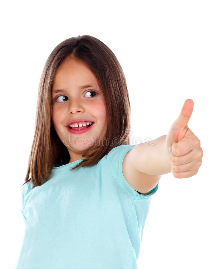 Friendly child saying Ok with her thumbs royalty free stock photo
